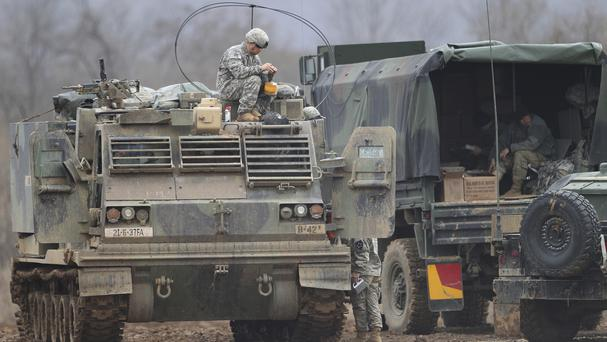 A US soldier sits on an armoured vehicle during an exercise in Yeoncheon, near the border with North Korea (AP)