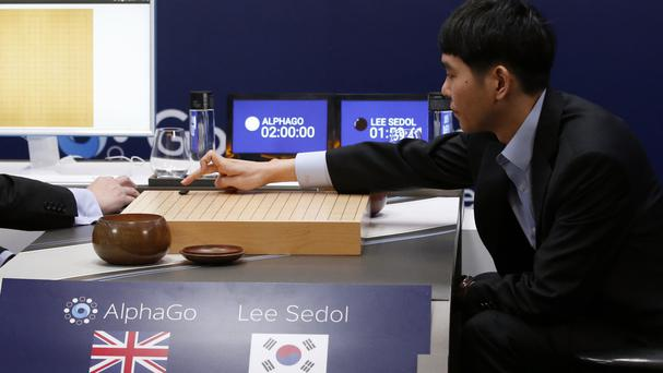 Lee Sedol makes his first move against Google's artificial intelligence programme AlphaGo (AP)