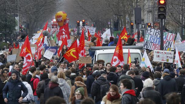 Demonstrators march during a rally in Paris (AP)