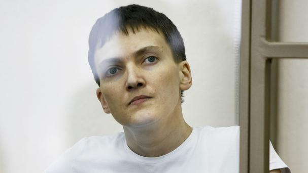Ukrainian Nadezhda Savchenko sits in a glass cage during a trial in Donetsk (AP)
