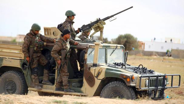 Tunisian soldiers search for attackers still at large on the outskirts of Ben Guerdane (AP)