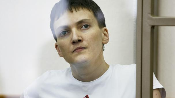 Ukrainian Nadezhda Savchenko sits in a glass cage during a trial in the town of Donetsk (AP)