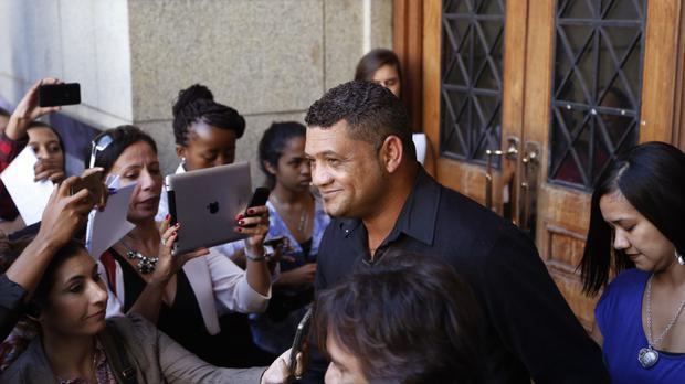 Morne Nurse, the father of a child kidnapped in 1997, leaves court in Cape Town, South Africa (AP)