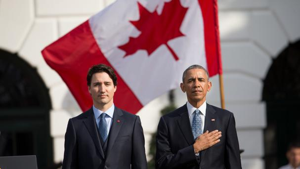 US President Barack Obama and Canadian Prime Minister Justin Trudeau stand for the playing of national anthems at the White House (AP)