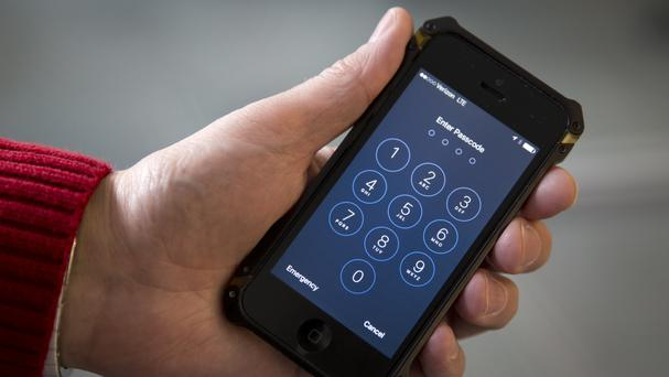 A locked iPhone used by one of the San Bernardino killers is thought to hold evidence of the eventual attack, the US Justice Department has said (AP)