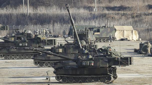 US Army self-propelled howitzers in position during the annual exercise with their South Korean counterparts in Pocheon, near the border with North Korea (AP)