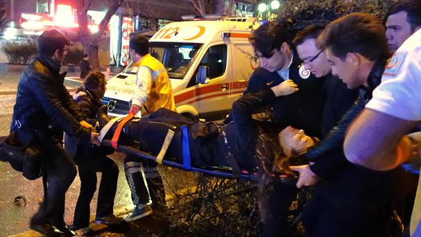 Medics ferry a casualty from the explosion site in the centre of Ankara (AP)