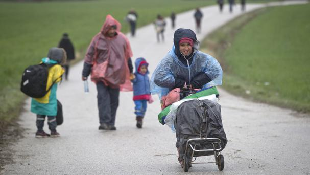 Migrants walk along a road after they were turned back from Macedonia, north of Idomeni, Greece (AP)