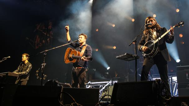 Mumford & Sons and Kanye West will participate in a collaborative album, Metamorphoses, for Global Citizen (Rich Fury/Invision/AP)