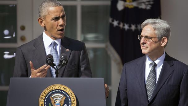 Federal appeals court judge Merrick Garland stands with President Barack Obama