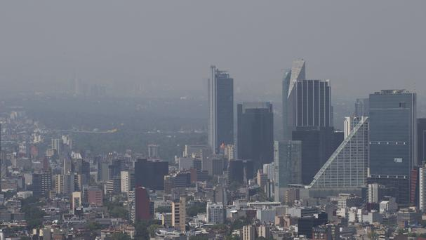 Haze hangs over Mexico City as cars are pulled off the roads (AP)