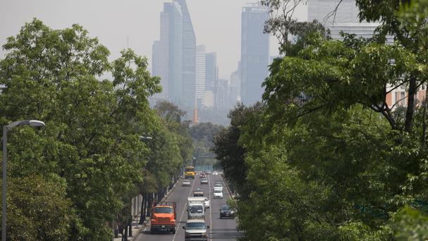 Haze hangs over Mexico City as authorities banned more than a million cars from the roads (AP)