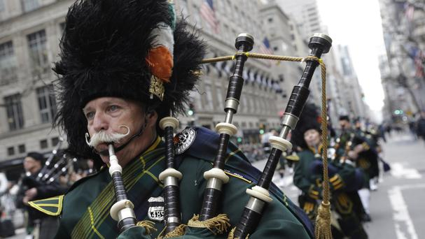 Bagpipers march up Fifth Avenue during the St Patrick's Day Parade in New York (AP)