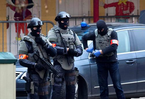Special operations police secure an area during a police raid in the Molenbeek neighbourhood of Brussels, Belgium on Friday, March 18, 2016. Two French police officials have told The Associated Press that Salah Abdeslam, the main fugitive from Islamic extr