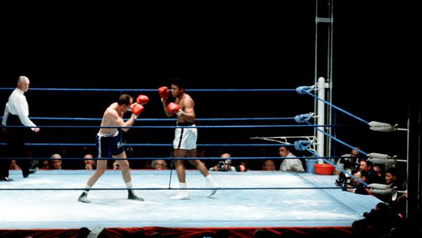 Muhammad Ali seen fighting Henry Cooper at Highbury