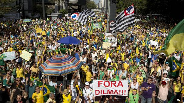 Demonstrators demand the impeachment of Brazilian President Dilma Rousseff in Sao Paulo. Brazil's real is down 12pc in the past year despite a rally this year fueled by traders' optimism that Rousseff will soon be gone. (Photo: AP)