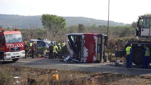Rescue workers at the scene of a bus accident in Spain (AP)