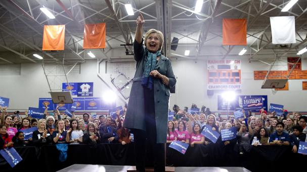 Democratic presidential candidate Hillary Clinton turns to acknowledge the cheering crowdin Seattle (AP)