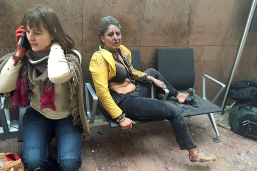 Air hostess Nidhi Chaphekar, from India, covered in blood and debris in Brussels Airport. Photo: Ketevan Kardava