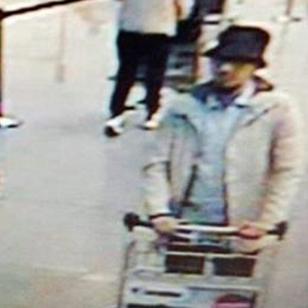 The mystery terrorist in a still from CCTV footage at Brussels Airport. Photo: Reuters