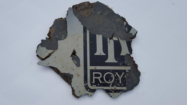 This suspected plane part found on the southern coast of South Africa may be from one of Malaysia Airlines Flight 370's Rolls-Royce engines (AP)