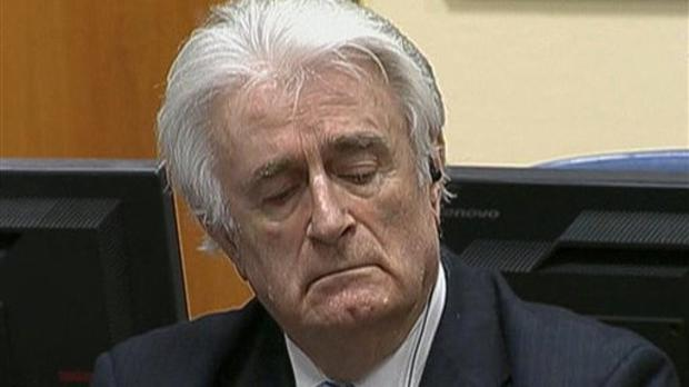 Radovan Karadzic listens to his sentence at the International Criminal Tribunal for Former Yugoslavia (ICTY) in The Hague, The Netherlands (ICTY via AP)