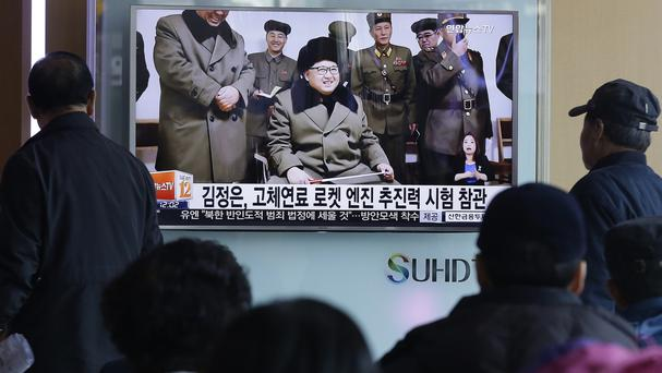 People watch a TV screen showing North Korean leader Kim Jong Un during a news programme at Seoul Railway Station, South Korea (AP)