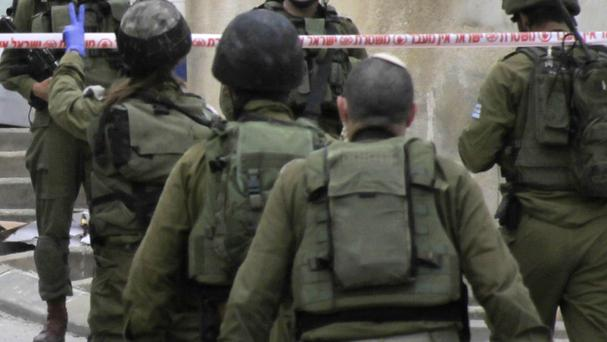 Israeli soldiers after a stabbing attack in Hebron, West Bank (AP)