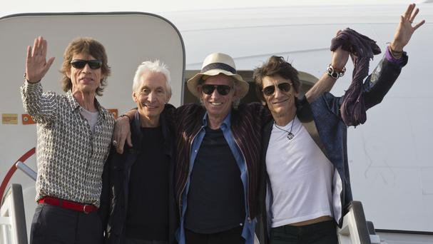 Left to right, Sir Mick Jagger, Charlie Watts, Keith Richards and Ronnie Wood arrive at Cuba's Jose Marti international airport (AP)