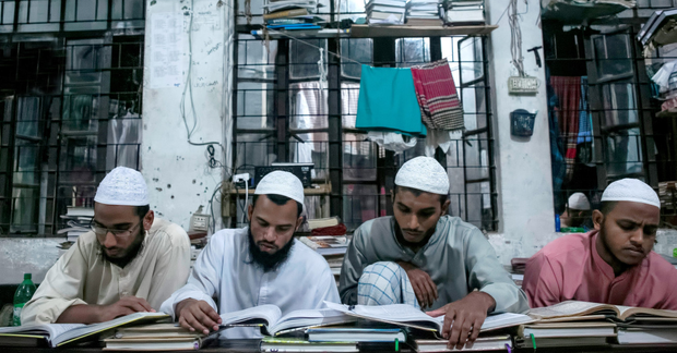 Inculated: Men study at the Jamia Rahmania Arabia madrassa in Dhaka, where Mufti Jasim Uddin Rahmani who is the the spiritual leader of the Islamic militant group, the Ansarullah Bangla Team, used to teach Photo: Alison Joyce