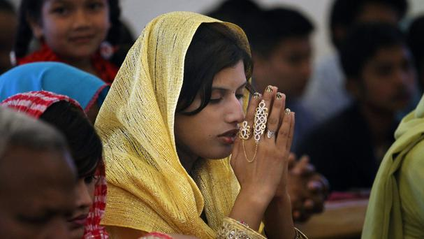 Worshippers pray during a Mass in Rawalpindi, Pakistan (AP)