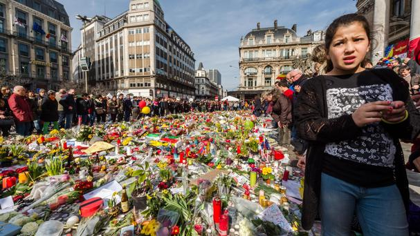 Floral tributes line a memorial site at the Place de la Bourse in Brussels (AP)