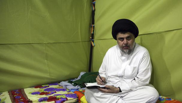Muqtada al-Sadr sits inside his tent during his sit-in inside the heavily guarded Green Zone (AP)