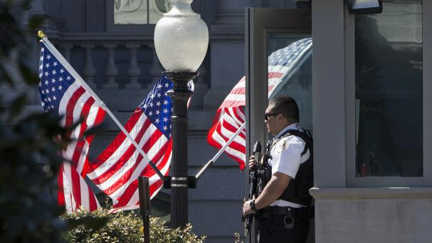 A Secret Service officer stands guard by the West Wing of the White House (AP)