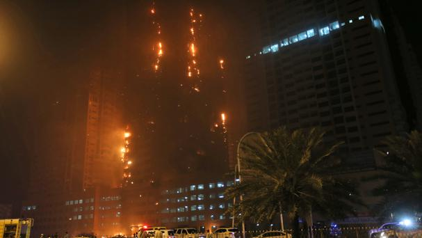 Fire and smoke billow from a high-rise building in Ajman, United Arab Emirates (AP)