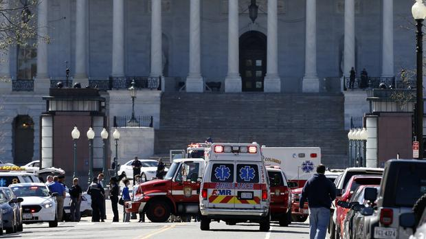 Police vehicles at Capitol Hill in Washington DC after reports of gunfire at the Capitol Visitor Centre complex (AP)