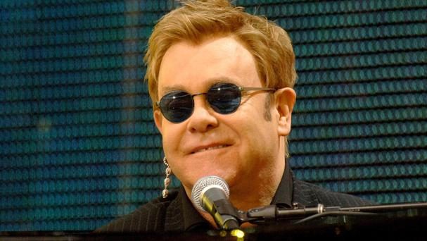 Sir Elton John faces a lawsuit alleging sexual harassment