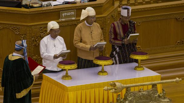 Htin Kyaw, second right, is sworn in as Burma's new president in parliament Naypyitaw (AP)