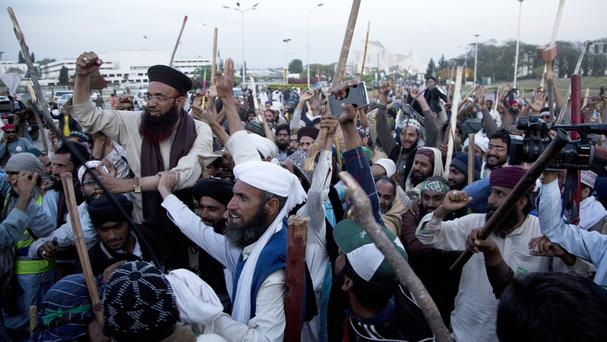 Protesters from Pakistan's Sunni Tehreek group celebrate the outcome of negotiations with the government (AP)