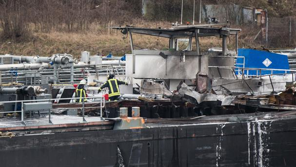 Firefighters on board a tanker which exploded in the Duisburg shipyard in western Germnay (Marcel Kusch/dpa via AP)