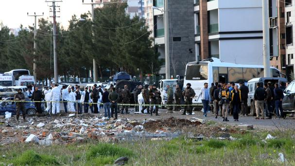 Security and forensic officials at the scene of an explosion in Diyarbakir, Turkey (AP)
