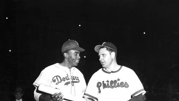 Jackie Robinson, left, prepares to play his first Philadelphia game for the Dodgers