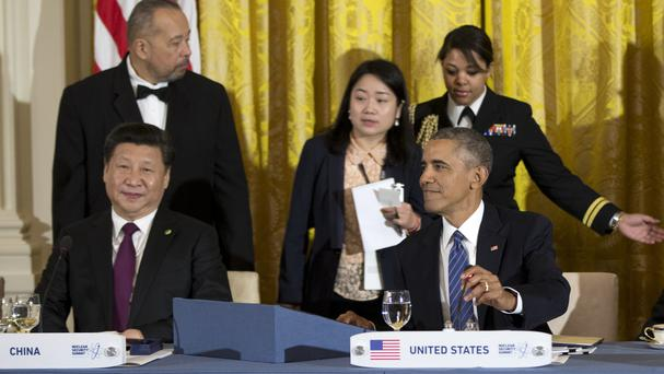 President Xi Jinping of China and Barack Obama gather for a working dinner at the Nuclear Security Summit in the White House (AP)