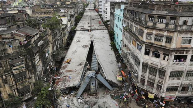 The partially collapsed overpass in Kolkata, India, where rescuers are searching for trapped people (AP)