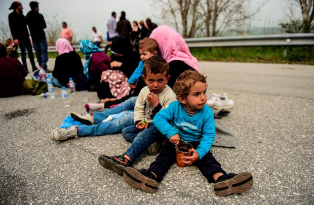 ROAD TO NOWHERE: Migrants block the highway near the town of Polykastro to press for the opening of the Greek-Macedonian border last week, after thousands of them were stranded by the Balkan border blockade. Waves of asylum seekers are stuck in Greece, after Balkan states sealed their borders. Photo: Kilic Bulent/Getty
