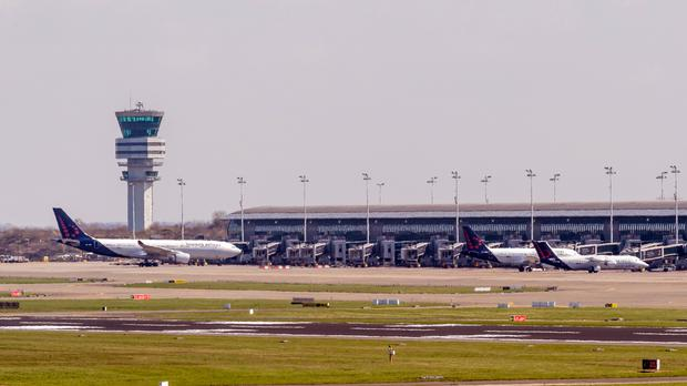 Three Brussels Airlines planes stand at departure gates at Brussels Airport (AP)