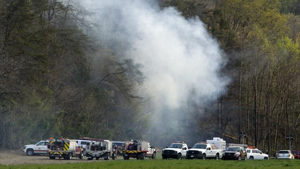 Emergency personnel work at the site of a tourist helicopter crash in Tennessee (AP)