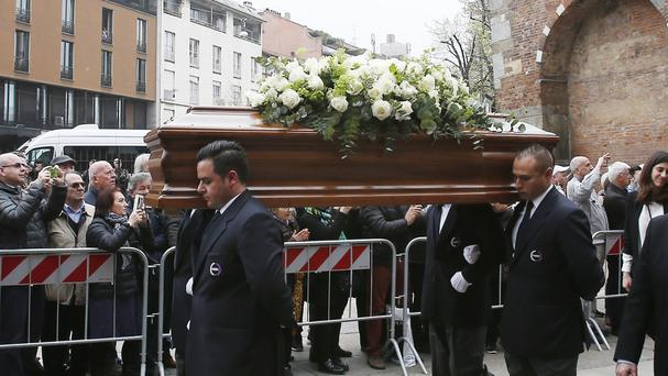 The coffin of former Italy coach Cesare Maldini is carried outside Milan's Sant'Ambrogio Basilica during his funeral