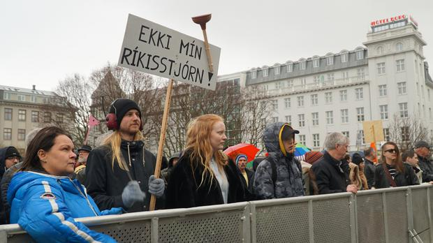 People protest in front of the parliament building in Reykjavik (AP)