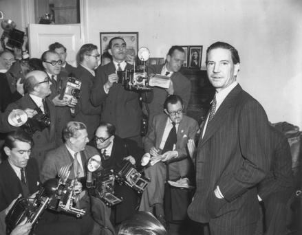 Close call: Philby at a press conference on November 8, 1955, after he was mistakenly cleared of being a spy.